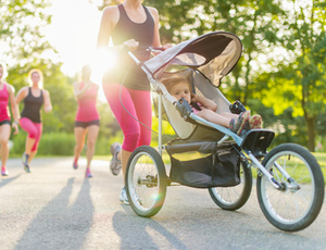 Woman jogging while pushing toddler in stroller